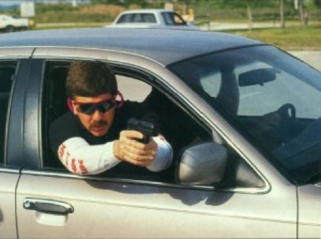 a picture of John Meyer, vehicle and shooting training at H&K